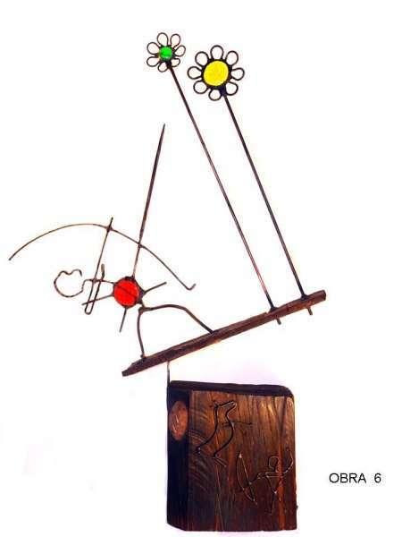 esculturas con vidrio madera cobre chatarra
